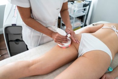 Woman at the spa getting laser treatment for her cellulite - beauty concepts